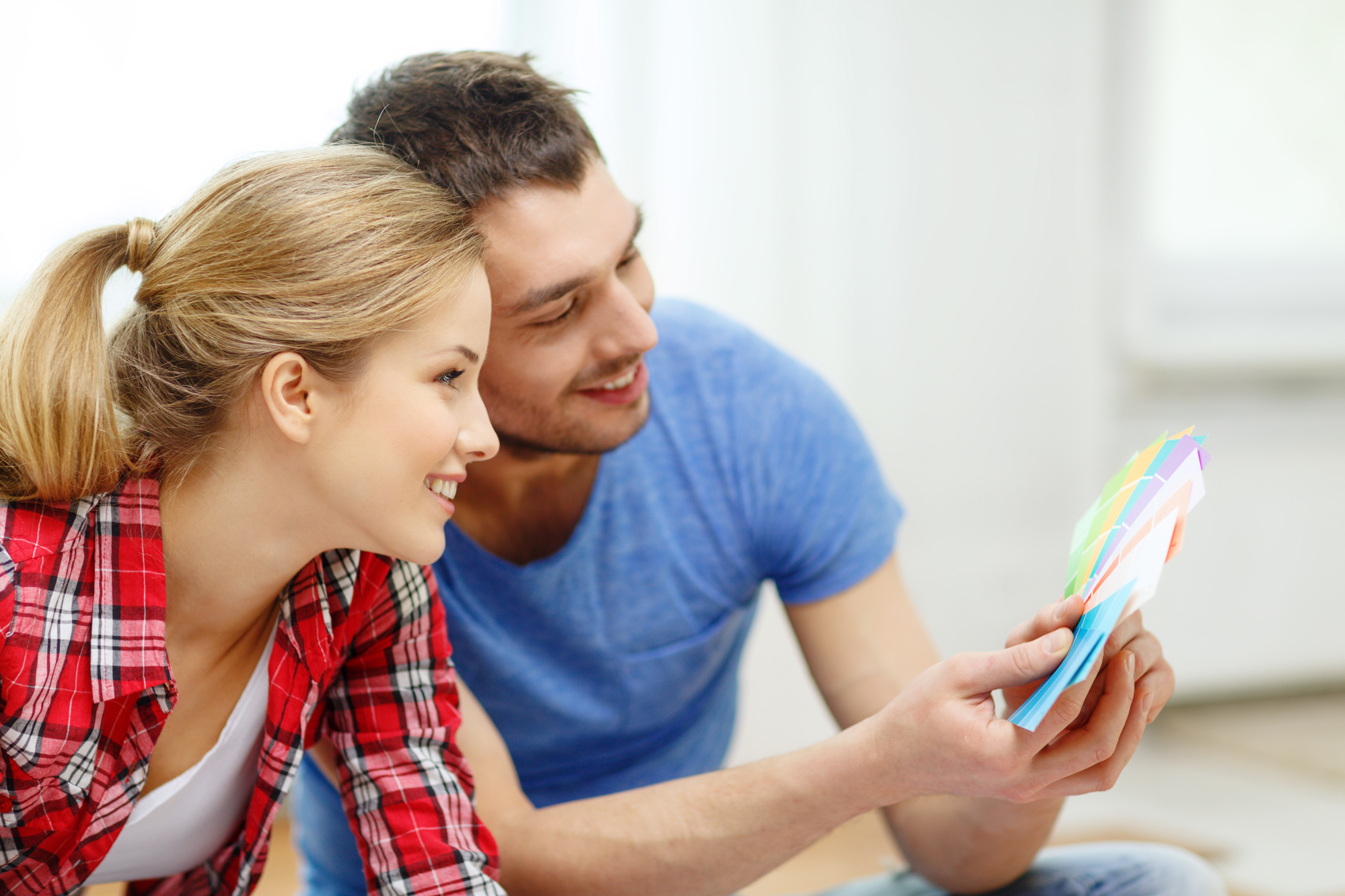 Smiling Couple Looking At Color Samples At Home